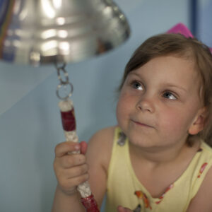 Olivia ringing the end of treatment bell
